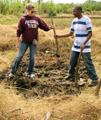 Becca FitzGerald helps Daniel Chinkhuntha in a demonstration on sustainable practices at Freedom Gardens.