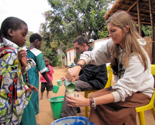 Virginia Tech students Kristen Haley and Lee Rakes  to the children of Malemia Primary School.
