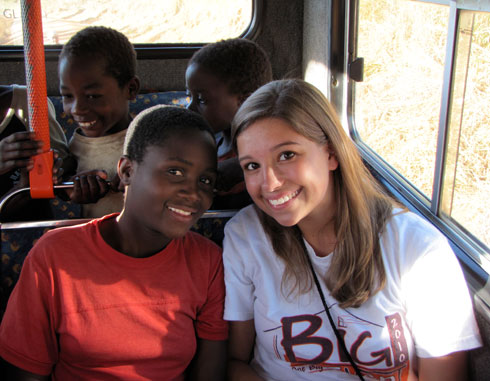 Children share the excitement of being on a bus with Virginia Tech sophomore Becca FitzGerald.