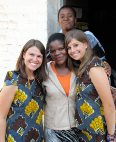 The teachers at Domasi Government School showed their appreciation by giving Malawian outfits to students Lauren Scheid and Rebecca FitzGerald.