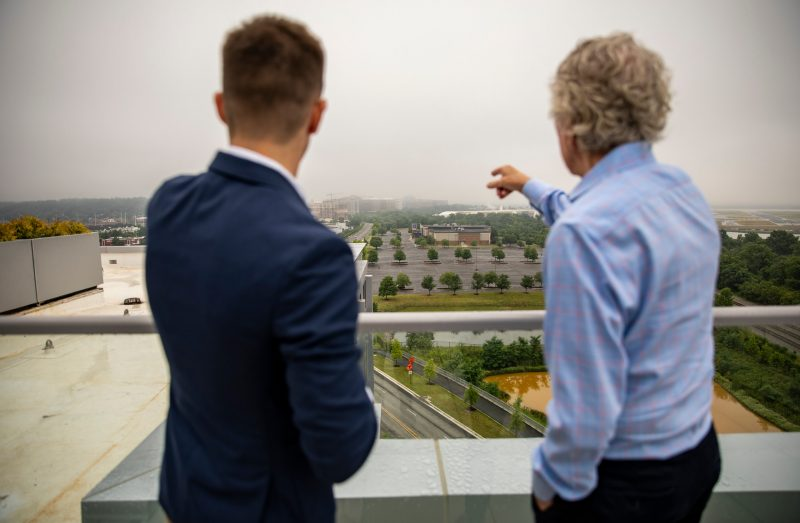 Attendees look out over the future Innovation Campus space.