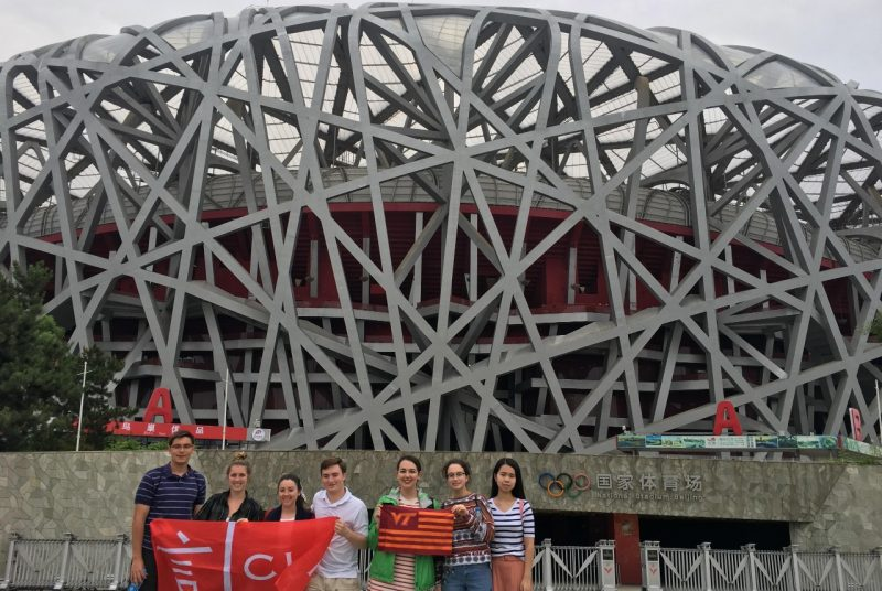 Virginia Tech students stand in front of the Olympic Stadium in Beijing, China