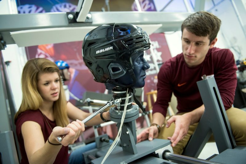 Graduate students work in the helmet lab